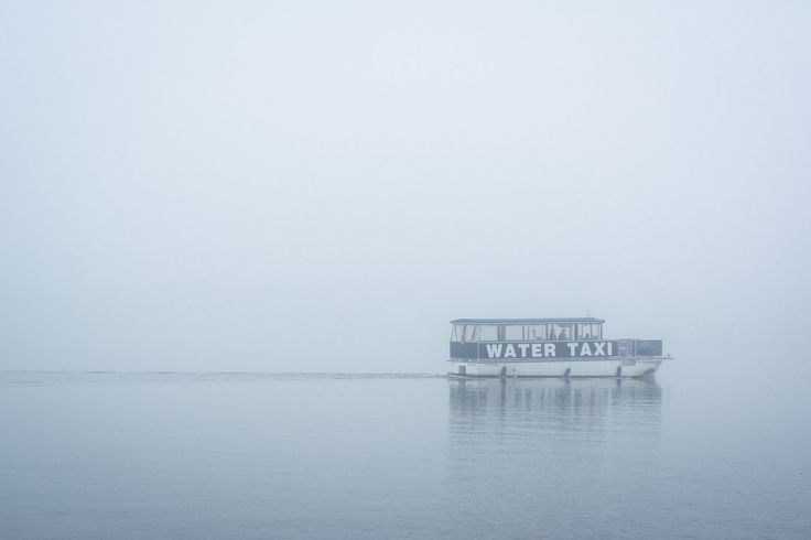 A water taxi in fog in Fells Point Baltimore, Maryland.