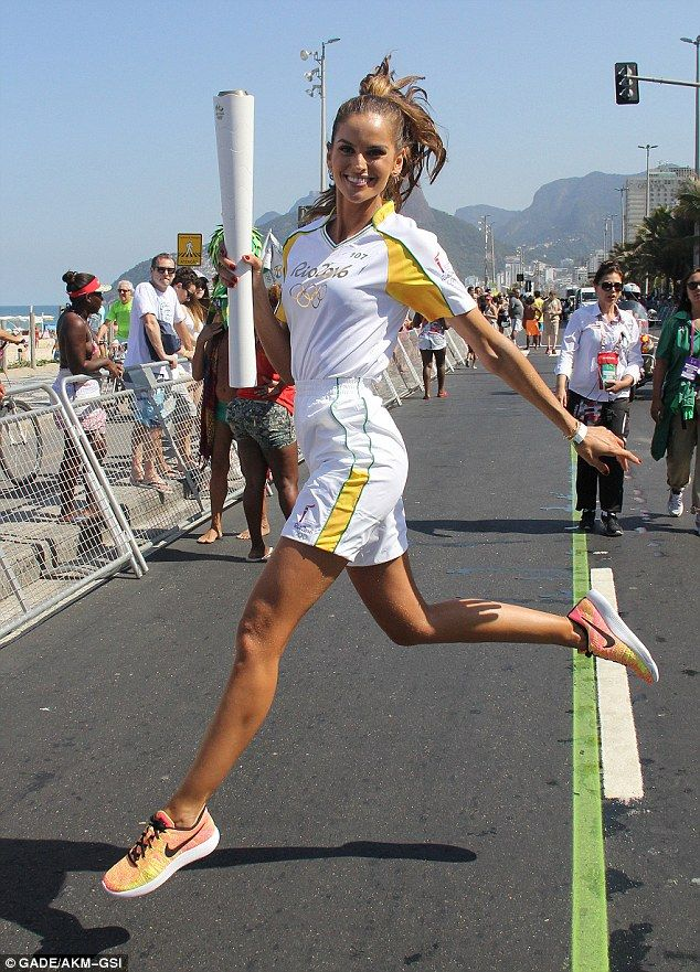Proud and fiery: Izabel was honored to pass the torch to official start the Olympic games in Rio de Janeiro on Friday