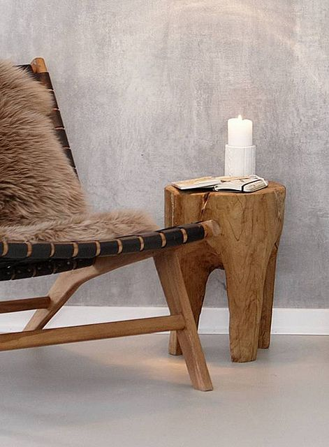 Rustic wood side table with a woven-fabric, chaise lounger.
