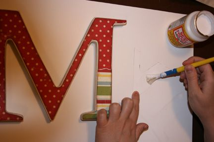 How to use modge podge to adhere scrapbook paper to wooden letters from the craft store. - someone remind me to show mom (: