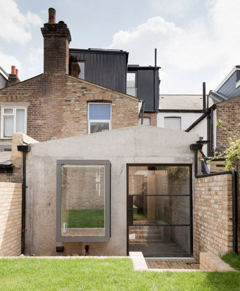 Nice mix of English mid-century brick and modern contemporary cement based architecture.