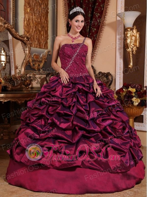 Best Burgundy Quinceanera Dress One Shoulder Taffeta Pick-ups Ball Gown  http://www.fashionos.com  The beads on the bodice and the strap makes the dress shinning and eye-catching. A pleated bodice with a lace up back shows out your charming and slim curves. The pick-ups on the skirt makes the skirt looks exactly big and delicate. Wearing the dress, you will surely be the shinning star.