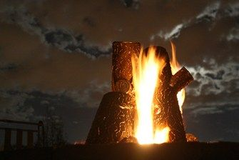 Steel Fire Logs - sculptural by day, glowing by night