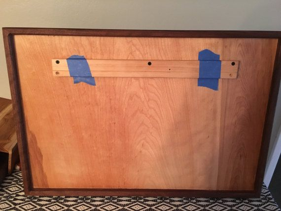 This American Walnut mini basketball hoop is handmade in my workshop in Northern California. It is 16x24 inches and comes with a 9 inch rim. It comes with a French cleat pre installed so the backboard will hang flush against the wall securely. Currently we are only offering Walnut but plan to expand to other hardwood soon. If there is a specific wood or size you are interested in feel free to send a message and we will do the best we can to accommodate. While the hoop is very strong and…