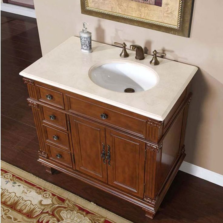 This traditional style 36 inch vanity is unique in that the under mount bowl is offset to the right leaving a larger open space on the marble counter top. Four drawers and an interior shelf mean you have plenty of options for storing personal items. This vanity does not include fixtures.