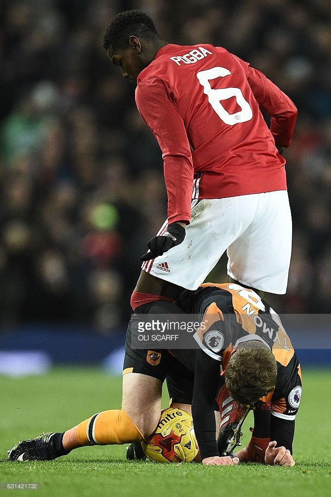 Manchester United's French midfielder Paul Pogba vies with Hull City's English defender Josh Tymon during the EFL (English Football League) Cup semi-final football match between Manchester United and Hull City at Old Trafford in Manchester, north west England on January 10, 2017. / AFP / Oli SCARFF / RESTRICTED TO EDITORIAL USE. No use with unauthorized audio, video, data, fixture lists, club/league logos or 'live' services. Online in-match use limited to 75 images, no video emulation. No…