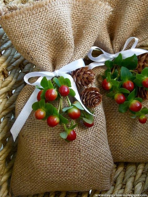 Use simple burlap bags and adorn with berries and pine #giftwrap #holiday: