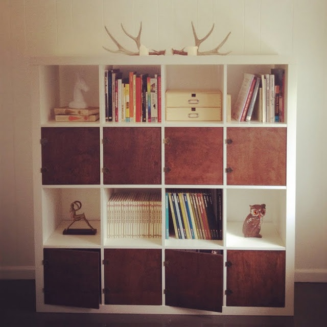 added doors. way better than baskets.. . This would work well in our apartment. We really need extra storage but I hate the super Ikea-ish look of Ikea storage: Ideas, Bookshelves, Ikea Bookshelf, Hacked Ikea, Living Room, Ikea Hacks, Ikea Hackers, Diy