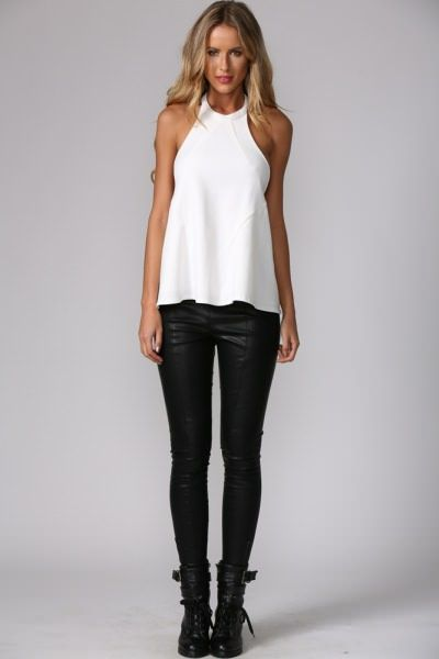 Rocker tomboy chic Sleeveless white top Bike boots Leather faux leather pants