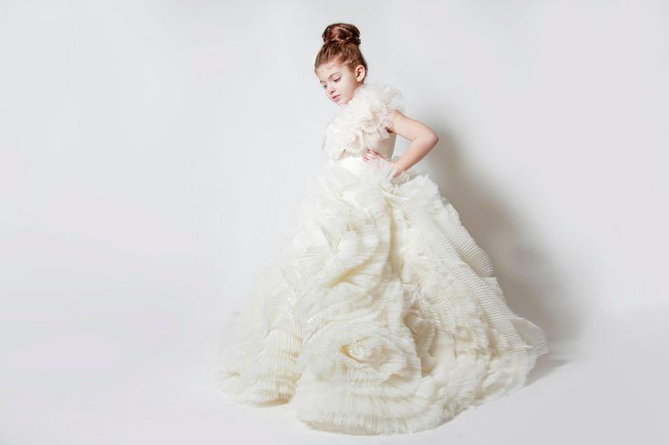 These winter 2013 couture flower girl looks from Lebanese designer Krikor Jobatian are just the thing. Seriously – these tiny dresses are show stealers! Can't you just image your flower girl floating down the aisle in one of these designs? What a lucky girl she'd be.