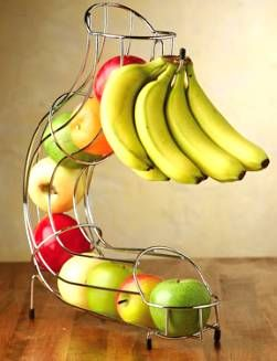 If you're like me, you buy lots of fruit and half of it gets thrown away because it goes bad. One huge reason this always happens to me is because I throw all my fruit in a big old bowl and the bananas take over. Well, now I see the answer: this awesome fruit rack! Your bananas hang at a safe distance, while your other little pieces of fruit can chill in the adjacent chute and won't get all bruised. Or worse, forgotten.