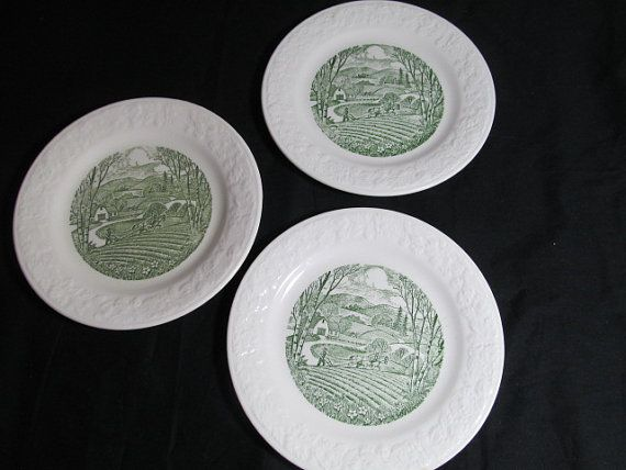 Vintage Laughlin bread and butter plates a painted green on white background. They measure 6 3/4 inches in diameter. They are in beautiful condition.  This note is from Homer Laughlin Decades of Dinnerware book. 1933 Ovenserve filed for registration as a trademark. The Ovenserve shapes were predominately kitchen and bake ware, but cups, saucers, plates were also produced. Identical Ovenserve pieces were marked with either Homer Laughlin or Taylor Smith & Taylor backstamp. The smaller...