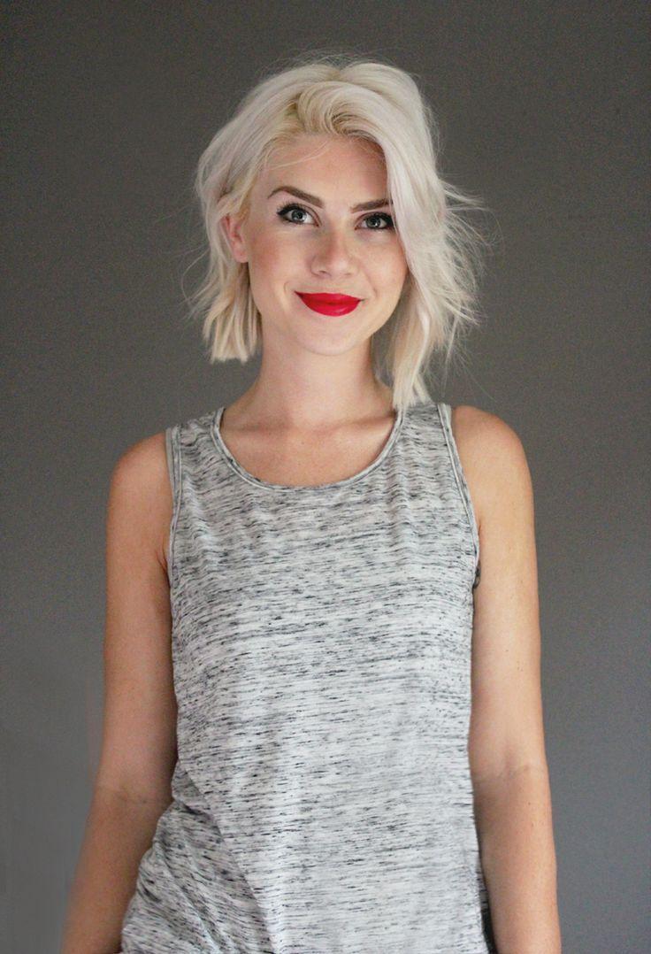 Cute hair! Platinum blonde blunt bob - choppy with red lipstick.