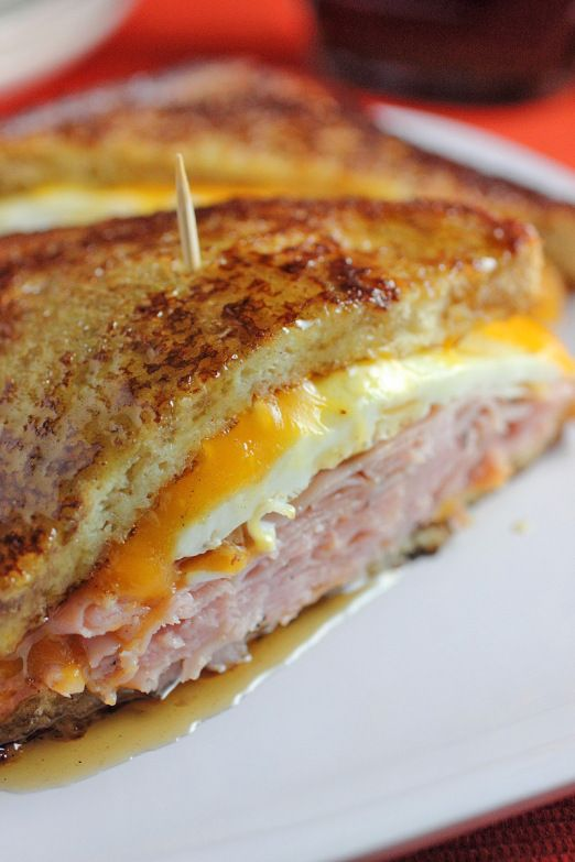 French Toast Breakfast Sandwich loaded with ham, egg and cheese.