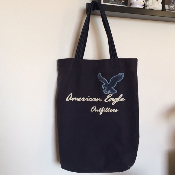 American eagle tote bag Perfect to carry books at school or other needs. There's some discoloration and snags on it as seen on the last two pictures. Inside has a zipper pocket. American Eagle Outfitters Bags Totes