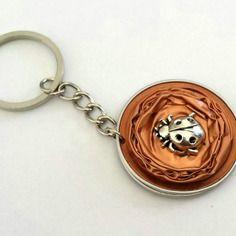Porte-clef ou bijou de sac en capsule de café nespresso de couleur