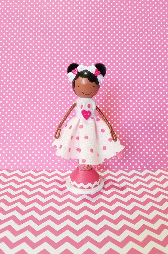 """SweetHeart Destiny African American Miniature Wooden -Clothespin Doll-""""Destiny"""", a super cute wooden clothespin doll stands just over four inches tall, and is uniquely hand painted in vibrant colors and wears a real cotton fabric dress in a white and dark pink polka dot print with dark pink tulle underskirting."""