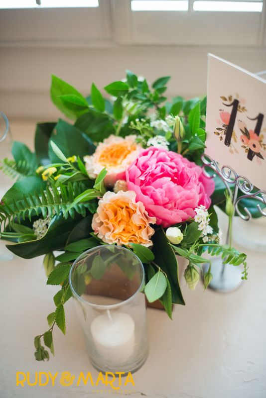 centerpieces of coral charm peony, peach campanella roses, yellow button chamomile, spirea , citrus, lisianthus and scabiosa buds,magnolia, fern, elm and lemon leaf in lovely varnished wood boxes.