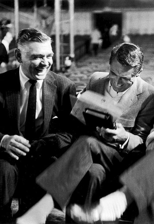 Clark Gable and Cary Grant during rehearsals for the 30th annual Academy Awards, 1958.