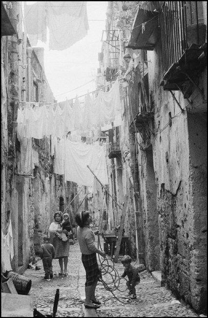 ferdinando scianna(1943- ), italy, bagheria, sicily, life in the street of a village.
