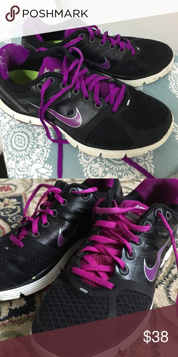 Nike Lunarglide 2 Sneakers Black and purple Nike sneakers! GUC, only bottoms of shoes have wear; there is something stuck to bottom of shoe. Otherwise, great! Just looking for a new home! #nike #cheap #sneakers #athletic #purple #black Nike Shoes Sneakers