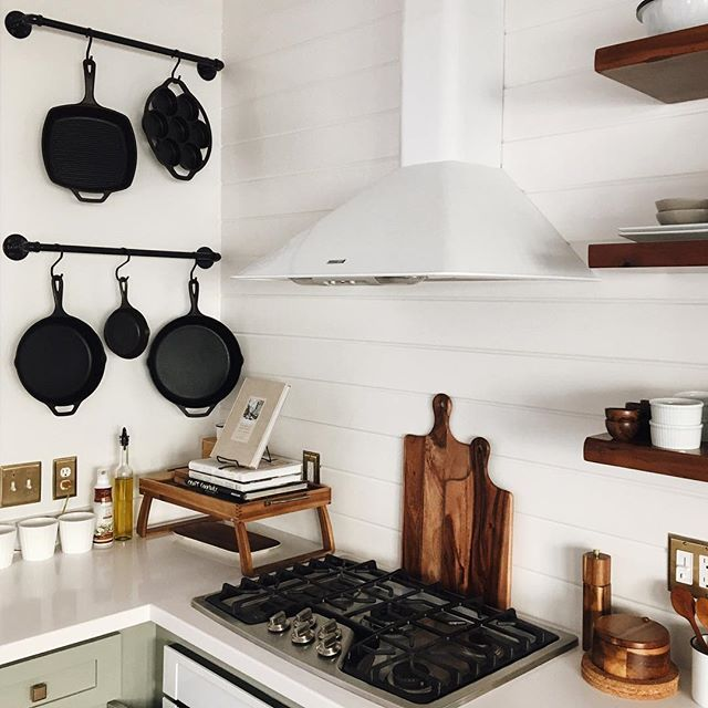 """When we decided on a that gorgeous mid century modern chandelier and lost, what I like to call, """"a country pot rack"""" above our island, I was like """"well where am I gonna store my cast iron pans now?"""" I mean I'm from Bakersfield, which is pretty countraaay #ohheydwightyoakam but I just can't get behind a traditional pot rack. If you have one hanging in your kitchen right now then I take it back and I'm sorry. Anyway, now that I made it awkward I just wanted to let you know Walt made an…"""