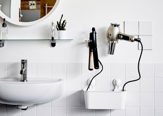 Keep your hair in check all the easier with a couple of hairstylist inspired holsters made from soap dispenser holders right by the mirror. You could add a container underneath for cable organization too.