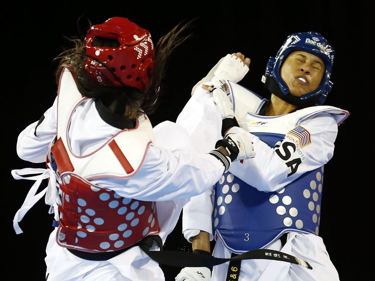 Paige McPherson of the the United States (blue) fights Julia Vasconcelos of Brazil (red) in the women's taekwondo 67kg semifinals.  Jeffrey Swinger, USA TODAY Sports