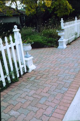 Pacific Interlock's Universal paver in B4 (red/tan/charcoal) bordered by Holland in Red, make this walkway stunning.