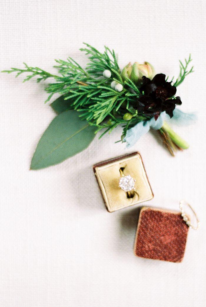 Solitaire Engagement Ring with a Winter Greenery Boutonniere  https://heyweddinglady.com/warm-winter-wedding-colors-timeless-style/    #wedding#weddinginspiration#weddingcolors#winterwedding#vintagewedding#engagementring #greenery