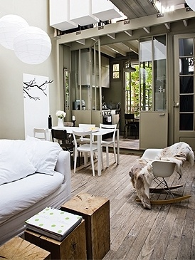 The raw wood floors + light