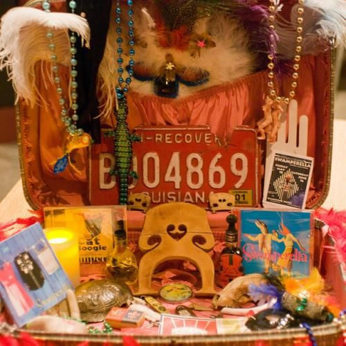 Suitcase shrine.  I adore this.  I love shrines and have been making them for about 20 odd years. I also Collect vintage suitcases...Brilliant idea!