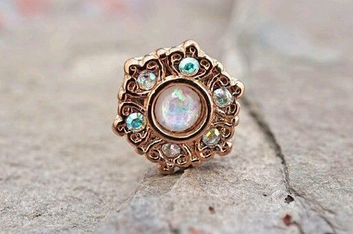 Ornate rose gold opal philtum/labret jewelry. Usually I hate rose gold, but this is lovely!