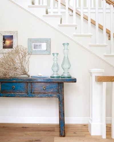 distressed blue painted table with tumble weed and blue candlesticks