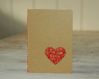 Kraft notebook bound with red embroidery floss in red in cahier stitch, 5 holes. This notebook is complete made by me. I have used Kraft carton, 300