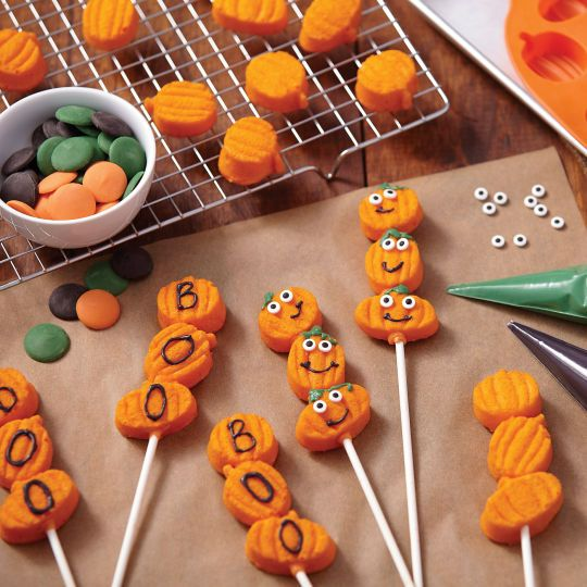Too cute to scare, these pumpkin cake lollipops are three times more fun to serve and eat! Tint ...