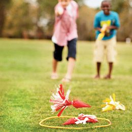 diy kid friendly version of lawn darts using plastic shopping bags filled with sand and covered with coloured duct tape