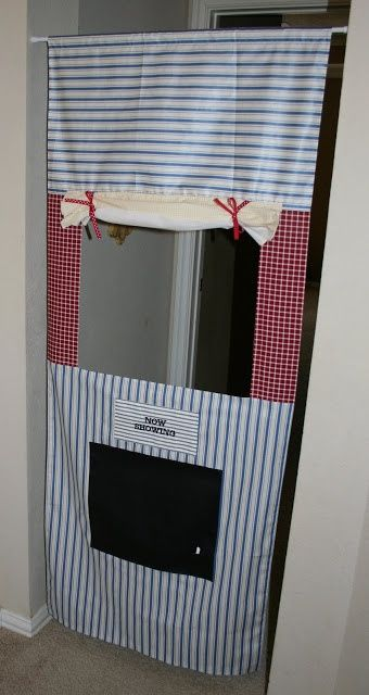 doorway puppet theater with a chalkboard marquee