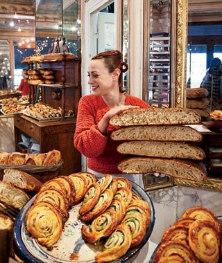 The Foodie's Travel Bucket List  Paris, France- Breakfast: Head to the crêpe stand at the Ave. Président Wilson market (Wednesday and Saturday) for buckwheat galettes with andouillette, ham, cheese, and egg. Lunch: Arpège ($$$$) always has a great selection of vegetables; the ravioli with fresh peas is a standout, as is the lobster. Snack: A loaf of yeasty pain des amis from Du Pain et Des Idées. Dinner: Order the lamb shoulder at Au Passage (33-1/43-55-07-52; $)