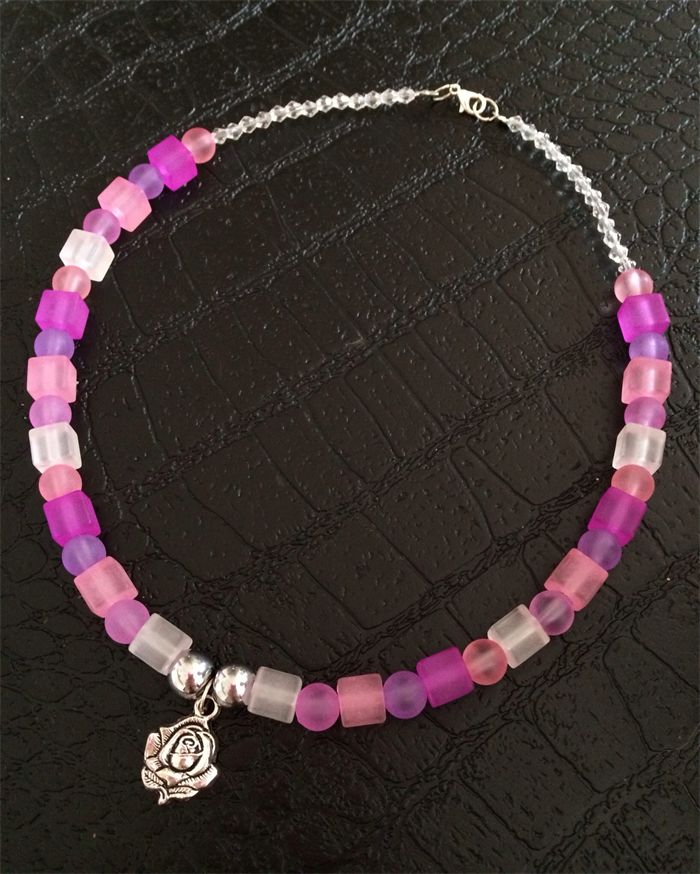 Beautiful pink and purple necklace with an elegant rose pendant