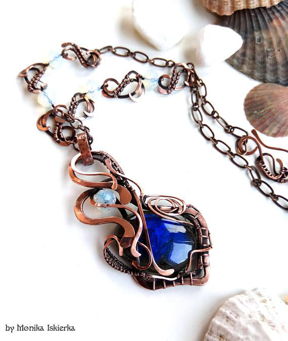 Meghan II- wire wrapped necklace, labradorite with blue flash and white opalite beads with beautiful flash inside. Oxidized/tinted, hammered and polished copper wire for ancient, old looking, vintage effect.  Pendant size is about 7,2 x 3,3 cm  100% handmade. Made by Monika Iskierka.