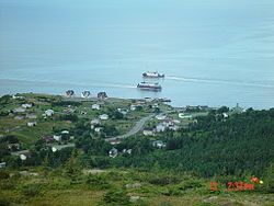 Portugal Cove, NL showing the two Bell Island ferries. Holy Rosary Church can be…