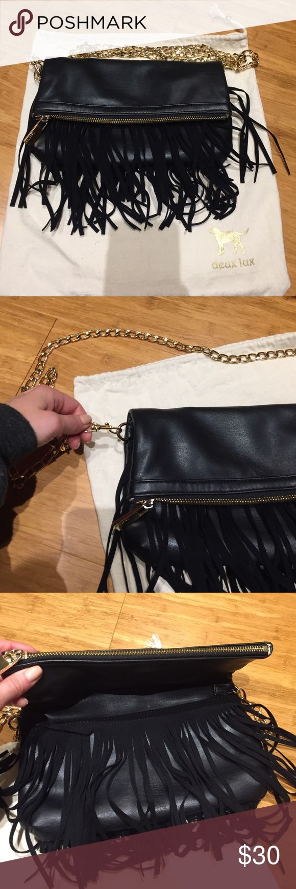 Fringe fold-over purse Gold chain that detaches. Comes with dust bag. Inside has some lipstick stains but exterior is in great condition. 10 inches wide 6 inches height folded over Deux Lux Bags Crossbody Bags