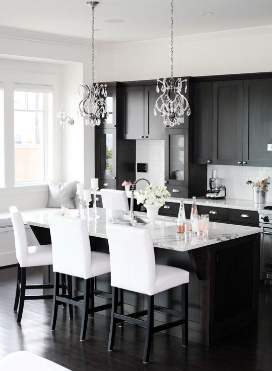 Love the shaker cabinets and the chandelier pendants.