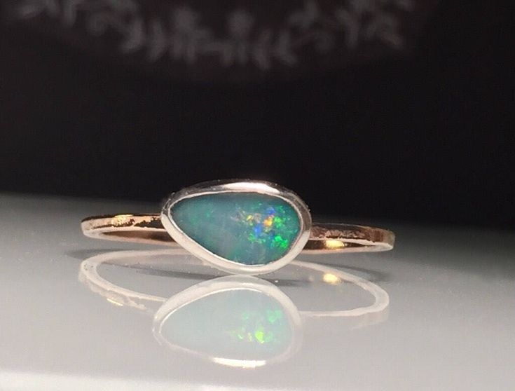 A personal favorite from my Etsy shop https://www.etsy.com/listing/568366906/rose-gold-opal-ringnatural-opal