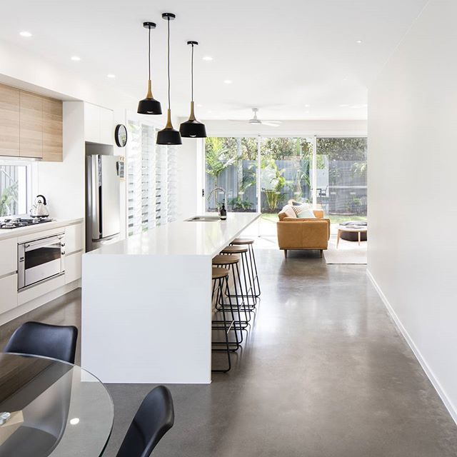 ORIENT DRIVE.    The burnished slab on this reno/extension came up magnificent.   #DLC #design #build #construct #house #renovation #polishedconcrete #timber #home #architecture @caesarstoneau @polytec #kitchen