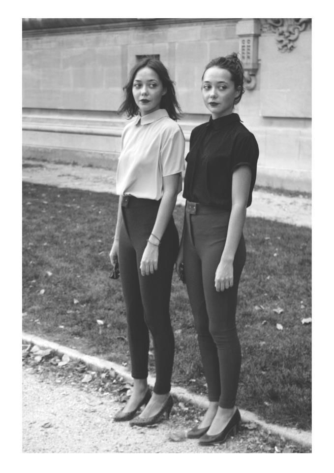 Two of a kind, in black and white: peter-pan collared blouses and American Apparel riding pants.