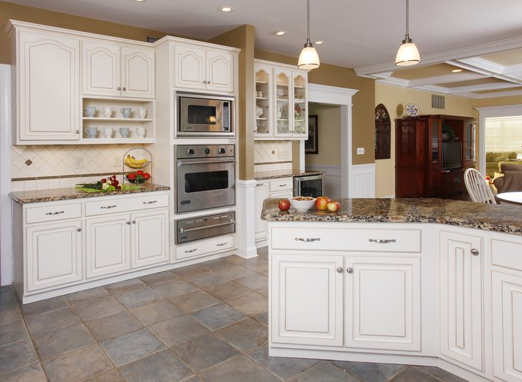 Winter white walnut glaze cabinets with a granite for Pictures of white glazed kitchen cabinets