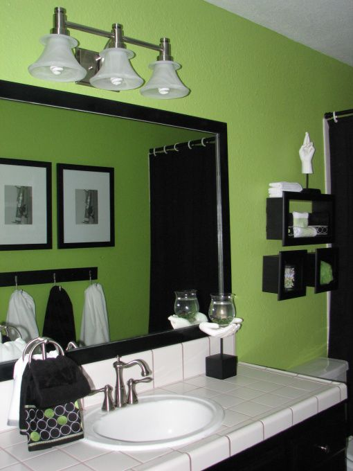 Lime green black and white are the chosen combination. New fixtures and brushed nickel hardware complete this room. towell bar is homemade., I took the suggestions I received and framed out the mirror.  I used molding cut it and painted it black. I used velcro to mount and sealed it with a clear caulk. I still dont believe I did it by myself., Bathrooms Design