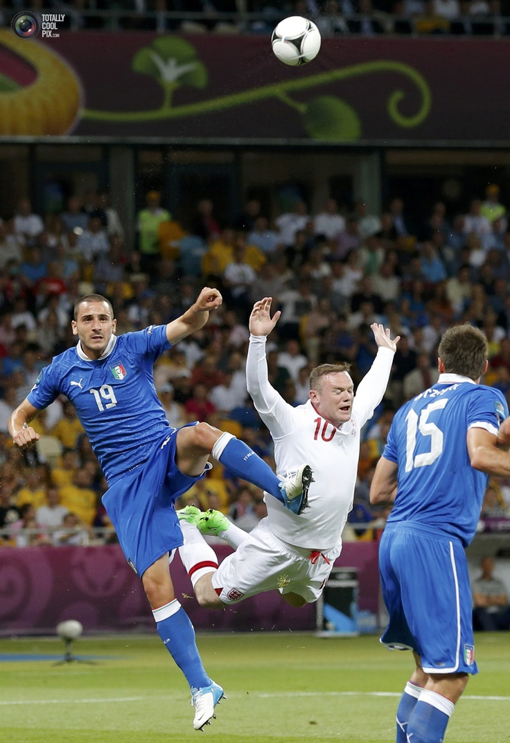 Italy's Bonucci and England's Rooney challenge for a high ball during their Euro 2012 quarter-final soccer match at the Olympic Stadium in Kiev. DARREN STAPLES/REUTERS: Euro 2012, High Ball, England S Rooney, Italy S Bonucci, Olympic Stadium, Rooney Challenge